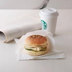 Tall-sized drink with a breakfast sandwich at $6.90 @ Starbucks