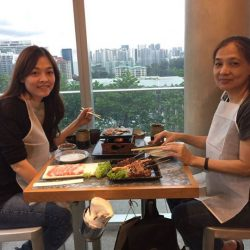 [Sumiya] Here are our customers enjoying our Japanese Wagyu Lava Grill against the pretty city skyline behind. And look! We also