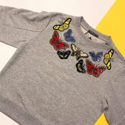 [The Fashion Gallery] Update your spring wardrobe with this Alexander McQueen jumper featuring intricate sequin-embroidered butterflies. - Visit our in-store @alexandermcqueen boutique