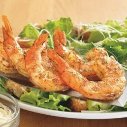 [Outback Steakhouse ] Our famous Caesar salad with grilled shrimp and crunchy croutons.