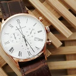 [Claude Bernard] This timepiece's vintage brown leather and elegant gold case offers a soft, glowing contrast for the sophisticated watch wearer.