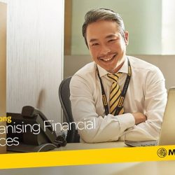 [Maybank ATM] Deputy Head of Maybank's Business Centre, David Chong, employs a non-pushy, consultative approach with his clients.