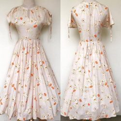 [Que Sera] 60s  cream cotton frock with orange flowers and a full knife pleat skirt.