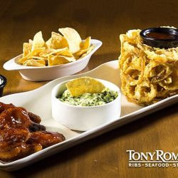 [Tony Roma's] Ideal for sharing, our Tony Sampler comes with a trio of appetizers, spicy wings, spinach artichoke dip and our signature